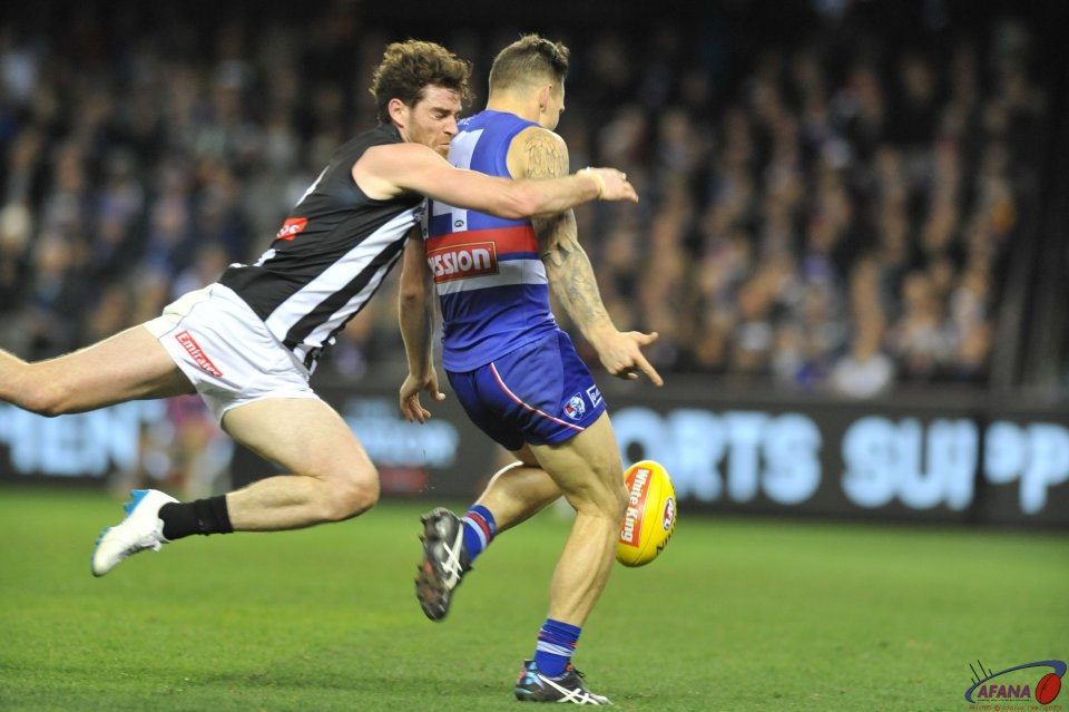 Tyson Goldsack tackles Bontempelli as he kicks and scores