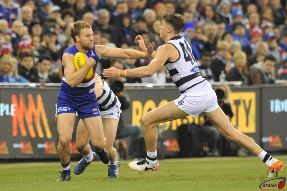 "Jake ""The Package"" Stringer fends off big Mark Blicavs"