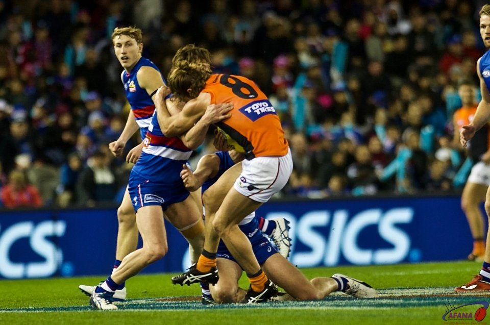 Callum Ward gets tackled by Liam Picken