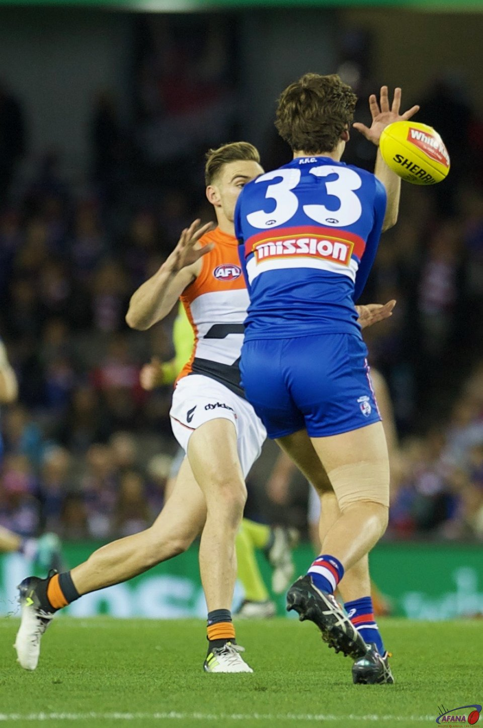 Lewis Young's handball is picked off by Stephen Coniglio