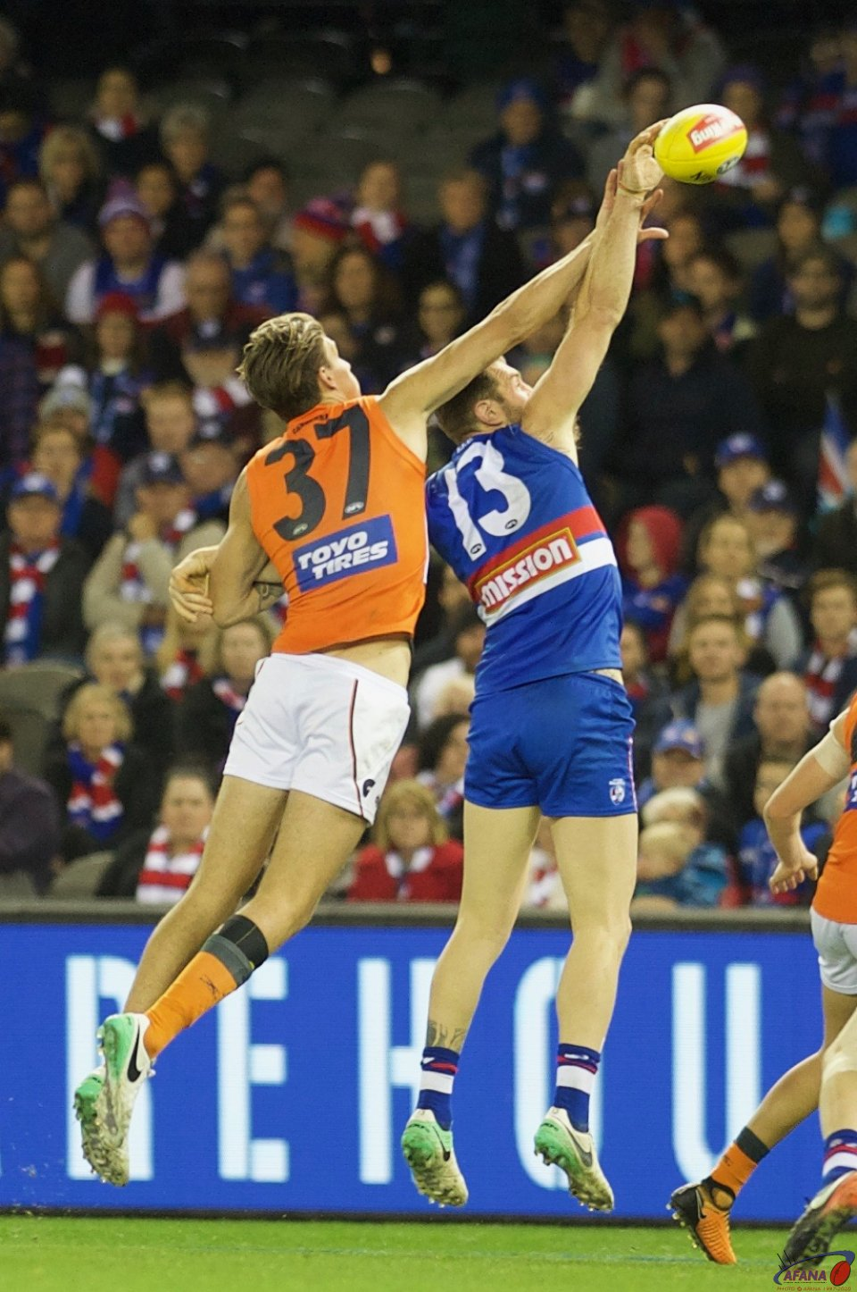 Rory Lobb and Travis Cloke contest the ball up