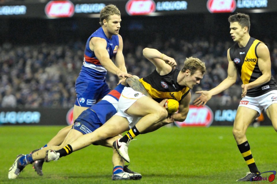 Caleb Daniel tackles David Astbury