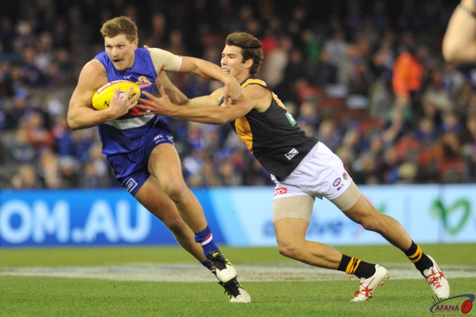 Jack Redpath escapes the clutches of Alex Rance