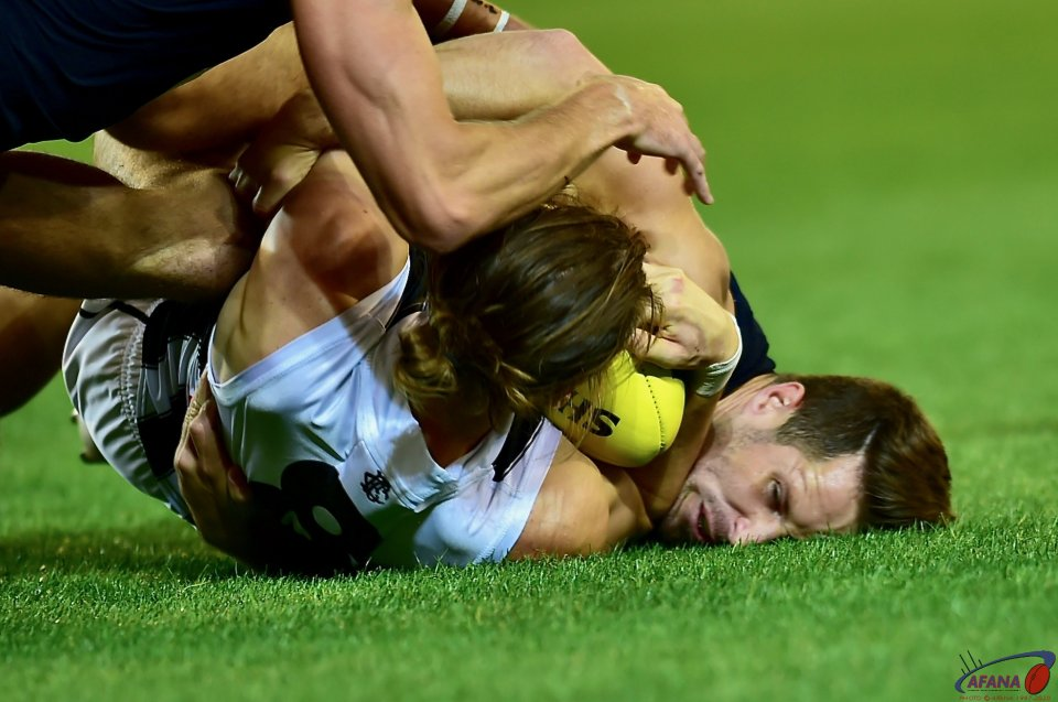 Tom Langdon wraps Cameron Polson up in a crunching tackle