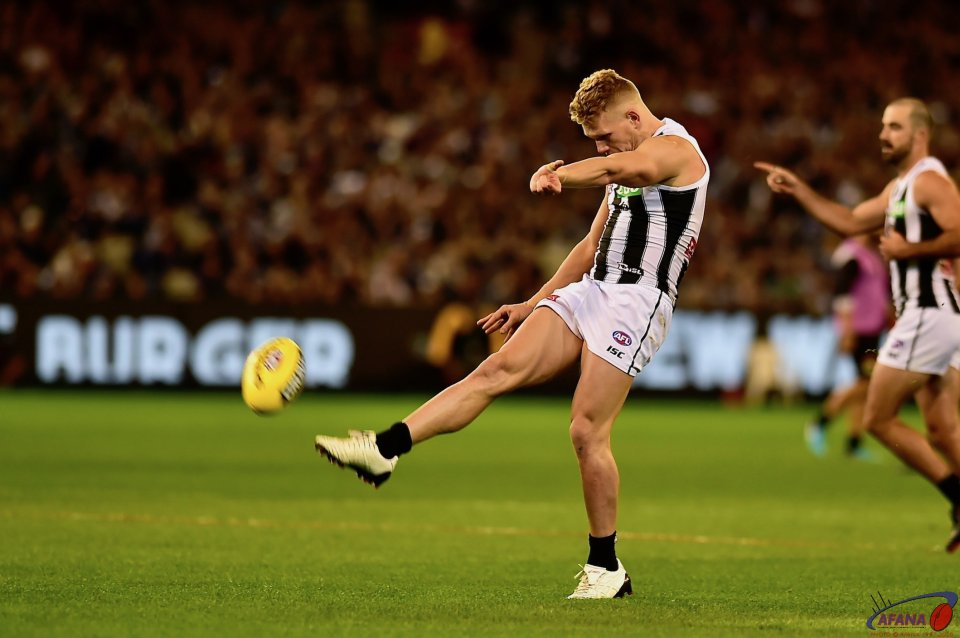 100 gamer Adam Treloar shoots and scores against the old enemy.