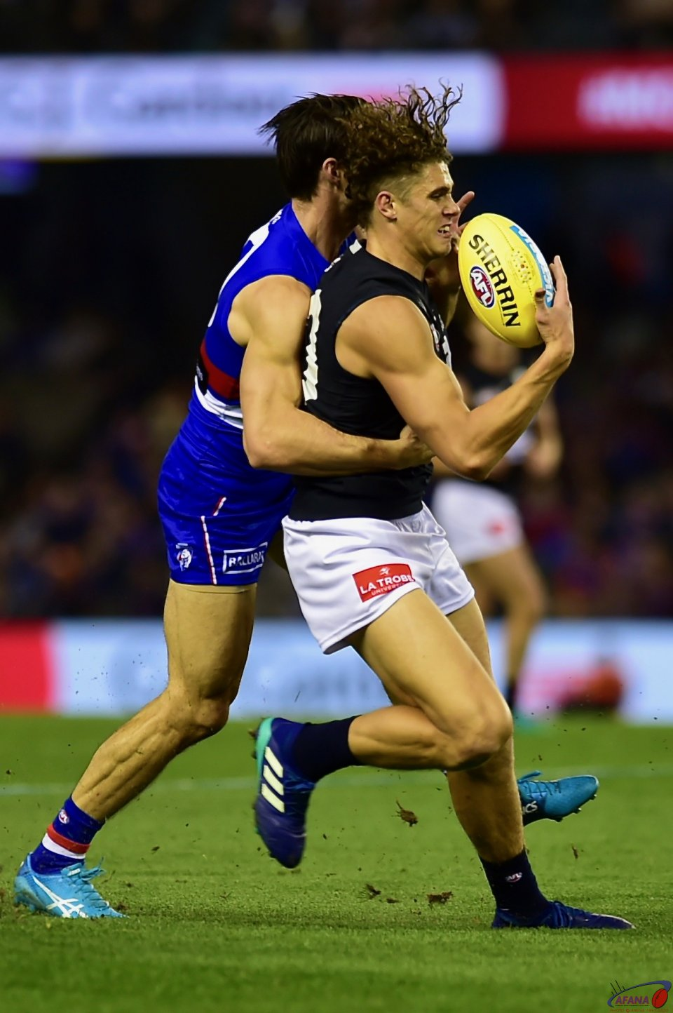 Charlie Curnow marks as Tom Boyd tries to spoil