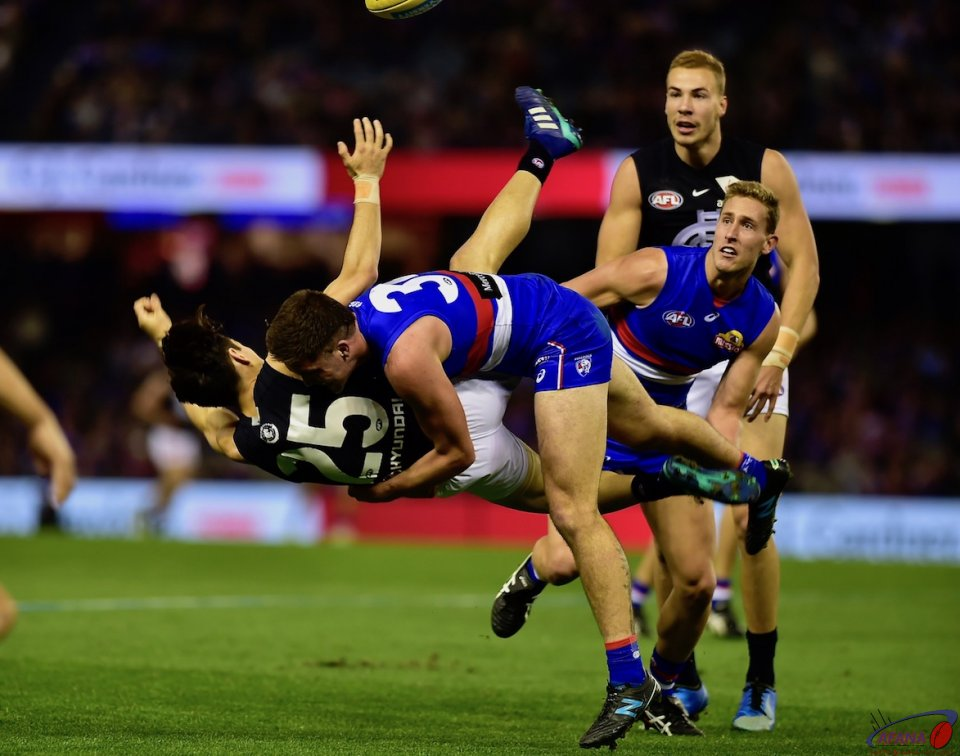 Dale Morris upends Carlton rookie Zac Fisher