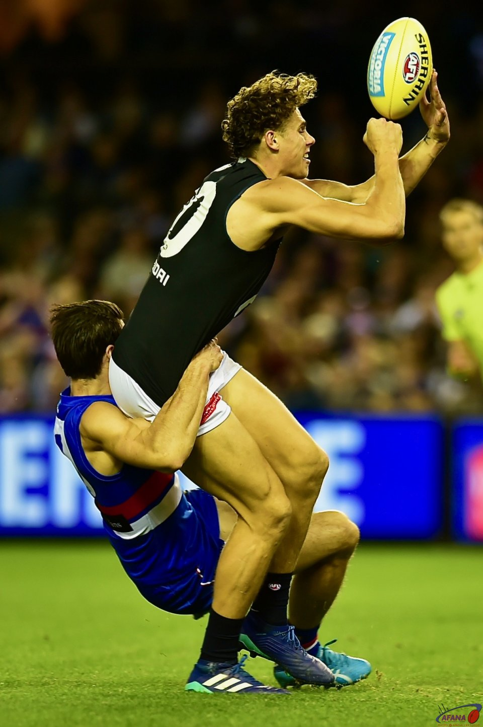 Tom Boyd tackles Charlie Curnow