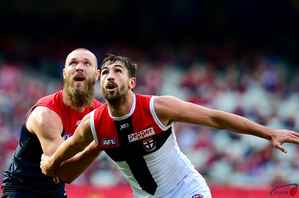 Gawn and Longer contest the ruck.
