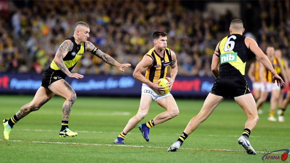 Dustin Martin chases Jaeger O'Meara