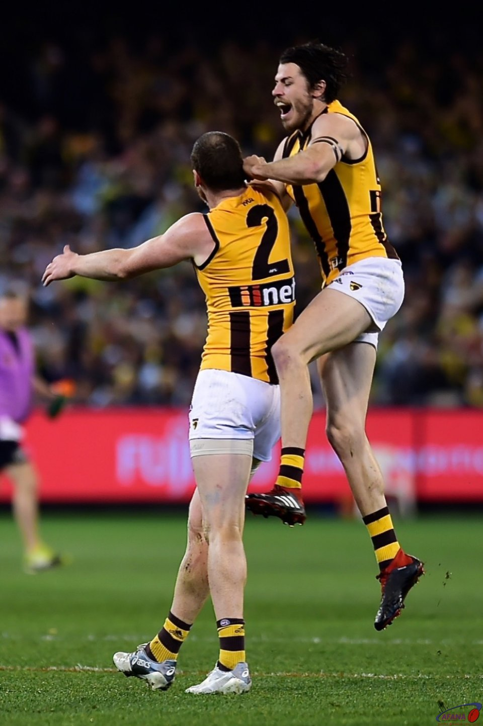 Jarryd Roughead and Isaac Smith celebrate